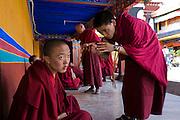 Monks speak outside the Jokhang Monastery in Lhasa, Tibet.