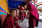 Monks speak outside the Jokhang Monastery in Lhasa, Tibet.