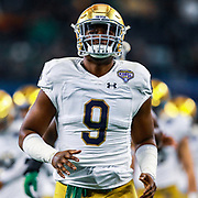 Notre Dame Fighting Irish defensive end Daelin Hayes (9) runs onto the field before the game of the NCAA Cotton Bowl  semi-final playoff football game against Clemson Tigers, Saturday, Dec. 29, 2018, in Arlington, Texas. Clemson defeated Notre Dame 30-3 to advance to the College Football Playoff national Championship. (Mario Terana/Image of Sport)