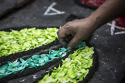 October 6, 2018 - Lima, Peru - Devotees making a carpet of flowers, outside the church where the image of the Lord of the Miracles will start the procesion. Every October for the past four centuries this procession takes place in Lima and is known as the most important religious event in Peru. This Peruvian tradition commemorates the devastating 1746 Lima earthquake which left only a mural of Christ standing in a city area. (Credit Image: © Guillermo Gutierrez/SOPA Images via ZUMA Wire)