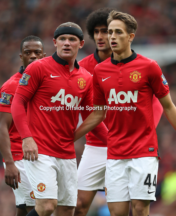 14th September 2013 - Barclays Premier League - Manchester United v Crystal Palace - Patrice Evra of Man Utd (L), Wayne Rooney of Man Utd (2L), Marouane Fellaini of Man Utd (2R) and Adnan Januzaj of Man Utd (R) - Photo: Simon Stacpoole / Offside.