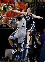 March 27, 2010; Sacramento, CA, USA; Gonzaga Bulldogs guard/forward Katelan Redmon (23) fouls Xavier Musketeers guard Dee Dee Jernigan (4) during the first half in the semifinals of the Sacramental regional in the 2010 NCAA womens basketball tournament at ARCO Arena. Xavier defeated Gonzaga 74-56.