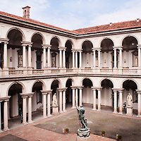 Courtyard of the Brera Palace in Milan. The construction dates back to 1651 by baroque architect Francesco Maria Ricchino and the Napoleon statue is from Antonio Canova.