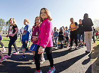 Renae Colby, Melissa Smith and Kristine Sweeney (far right of photo) from GMI Paving walk along with Pleasant Street students following the dedication of their new walking path on Wednesday morning.  (Karen Bobotas/for the Laconia Daily Sun)