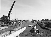 Kinsale Gas Pipeline to Dublin.1982.16.08.1982.08.16.1982.16th August 1982.The Kinsale to Dublin Gas Pipeline was scheduled to be commissioned in Jan '83..Image of one of the final sections of pipe being installed.The picture was taken at Inchicore,Dublin on the banks of The Grand Canal.