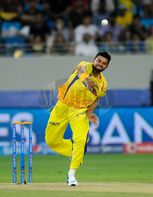 Suresh Raina of The Chennai Superkings bowls during match 10 of the Pepsi Indian Premier League Season 7 between the Chennai Superkings and the Rajasthan Royals held at the Dubai International Stadium, Dubai, United Arab Emirates on the 23rd April 2014<br /> <br /> Photo by Pal Pillai / IPL / SPORTZPICS