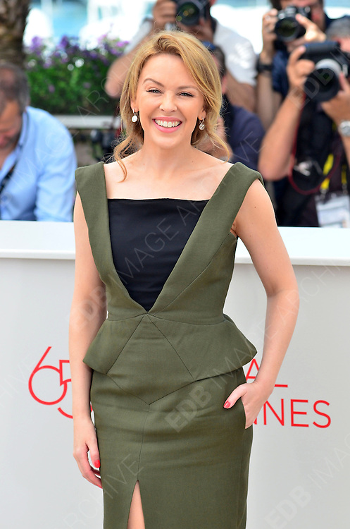 23.MAY.2012. CANNES<br /> <br /> KYLIE MINOGUE AT THE HOLY MOTORS PHOTOCALL DURING THE 65TH CANNES FILM FESTIVAL 2012, CANNES, FRANCE.<br /> <br /> BYLINE: EDBIMAGEARCHIVE.COM/JOE ALVAREZ <br /> <br /> *THIS IMAGE IS STRICTLY FOR UK NEWSPAPERS AND MAGAZINES ONLY*<br /> *FOR WORLD WIDE SALES AND WEB USE PLEASE CONTACT EDBIMAGEARCHIVE - 0208 954 5968*