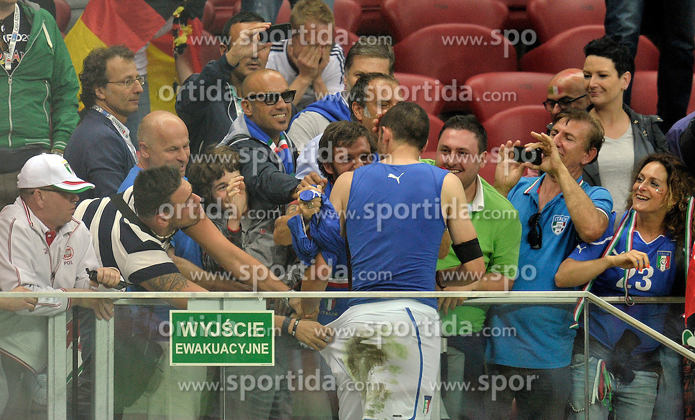 Italy's Leonardo Bonucci (nr19) thanks his supporters after the UEFA EURO 2012 Semifinal football match between Germany and Italy at National Stadium in Warsaw on June 28, 2012...Poland, Warsaw, June 28, 2012..Picture also available in RAW (NEF) or TIFF format on special request...For editorial use only. Any commercial or promotional use requires permission...Photo by © Adam Nurkiewicz / Mediasport