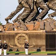 The Marine Corps Silent Drill Platoon performing at the Marine Corps Sunset Parade at the Marine Corps War Memorial (Iwo Jima Memorial) next to Arlington National Cemetery
