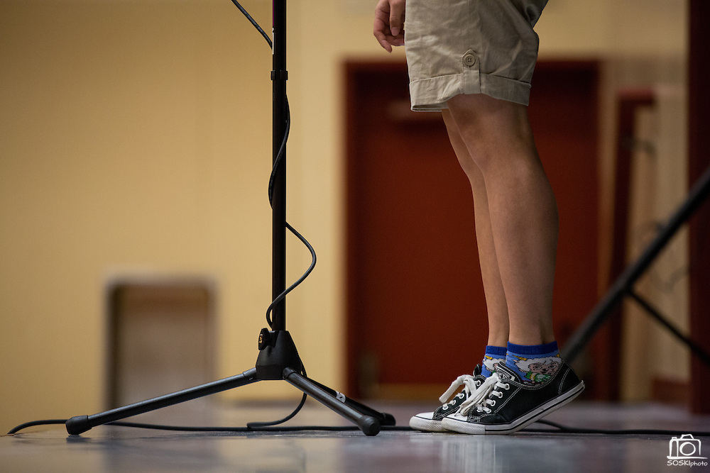 Eight grader Thuy-Mai Nguyen has to stand on her tiptoes during the 1st Annual Spelling Bee at Rancho Middle School in Milpitas, California, on December 9, 2015. (Stan Olszewski/SOSKIphoto)