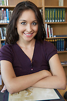 Female student in library, portrait