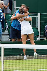 LONDON, ENGLAND - Monday, July 4, 2016:  Yaroslava Shvedova (KAZ) hugging her team after winning the Ladies' Single 4th Round match on day eight of the Wimbledon Lawn Tennis Championships at the All England Lawn Tennis and Croquet Club. (Pic by Kirsten Holst/Propaganda)