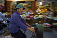 Street scene in one of the flower selling area's of the Old Quarter of Hanoi. Hanoi, estimated population 3,058,000(2004), is the capital of Vietnam. From 1010 until 1802, it was the political center of an independent Vietnam with a few brief interruptions. It was eclipsed by Hu during the Nguyen Dynasty as the capital of Vietnam, but served as the capital of French Indochina from 1887 to 1945. From 1945 to 1976, it was the capital of North Vietnam..The city is located on the right bank of the Red River. Hanoi is located 1760 km (1094 mi) north of Ho Chi Minh City (formerly Saigon). .