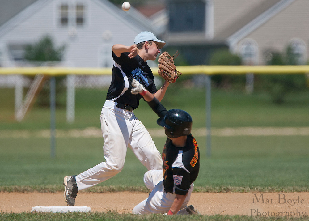 Pennsylvania's Mike Carey turns the double play as Maryland's Chance Crissinger tries to break it up during the winner take all final of the Eastern Regional Senior League tournament between Pennsylvania and Maryland held in West Deptford on Thursday, August 11.
