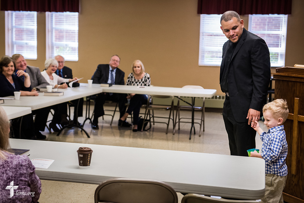 The Rev. Micah Glenn, national missionary to Ferguson, Mo., holds the hand of his son Jonathan during a presentation to supporters at Trinity Lutheran Church on Sunday, April 2, 2017, in Cape Girardeau, Mo. LCMS Communications/Erik M. Lunsford