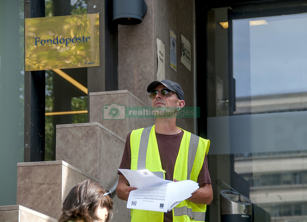 June 5, 2017 - Rome, Italy - A demonstration in front of the headquarters asking for a stabilization of the precarious workers of Italian post by ranking. On the white signs that the demonstrators bring, is written the date of expiration of their contract. (Credit Image: © Patrizia Cortellessa/Pacific Press via ZUMA Wire)