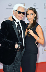 Karl Lagerfeld with Victoria Beckham  at the Bambi Awards 2013 at Stage Theatre in Berlin, Germany, Thursday, 14th November 2013. Picture by  Schneider-Press / i-Images<br /> UK &amp; USA ONLY