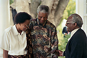 President Mandela with Graca Machel and Archbishop Desmond Tutu at the Lord Charles Hotel Sommerset West 1996. <br /> <br /> Photograph &copy; nic bothma