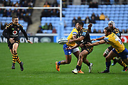 Wasps fly half Lima Sopoaga (10) gets a pass away under pressure during the Gallagher Premiership Rugby match between Wasps and Bath Rugby at the Ricoh Arena, Coventry, England on 2 November 2019.