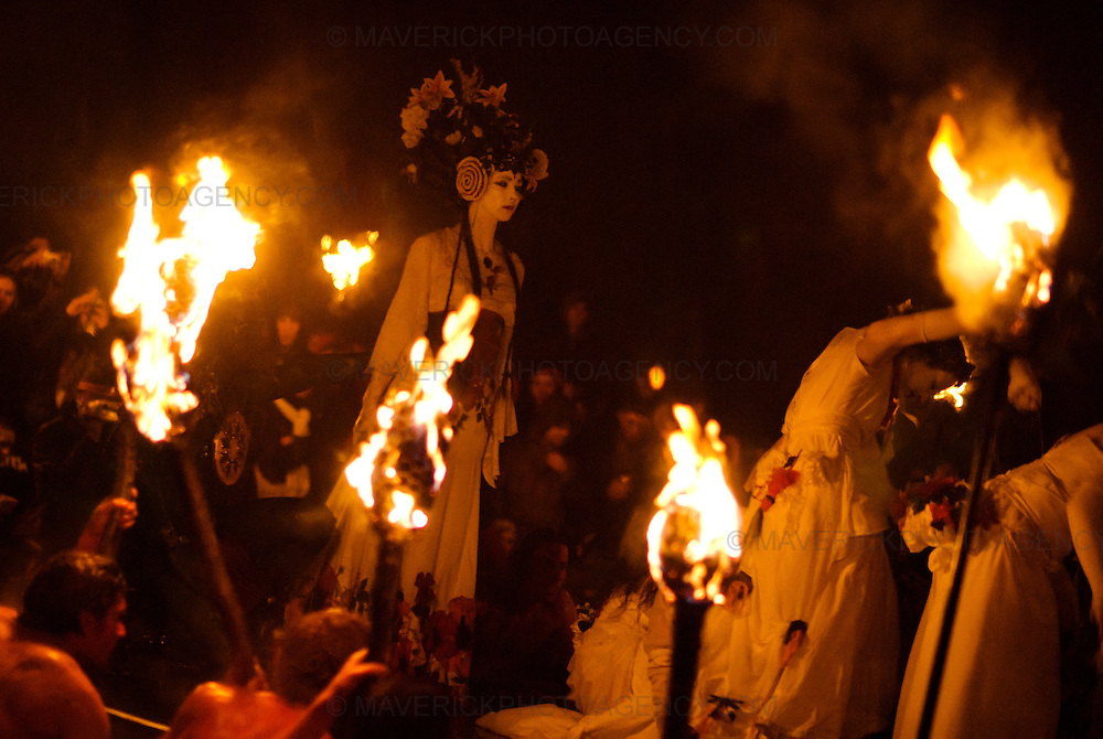 Members of the Beltane Society are seen celebrating the blossoming and fertility of spring on top of Calton Hill in Edinburgh, Scotland. The procession is a revival of the ancient Celtic festival of Beltane around three hundred voluntary performers celebrate the ending of winter in a spectacular procession of fire and colour. Pictured the May Queen.