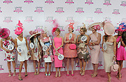 Krista Rosenberg, center, of Boca Raton, FL, reacts after winning the fashion contest and a Longines timepiece on Longines Kentucky Oaks Day, Friday, May 5, 2017, in Louisville, KY. Longines, the Swiss watch manufacturer known for its luxury timepieces, is the Official Watch and Timekeeper of the 143rd annual Kentucky Derby. (Photo by Diane Bondareff/AP Images for Longines)