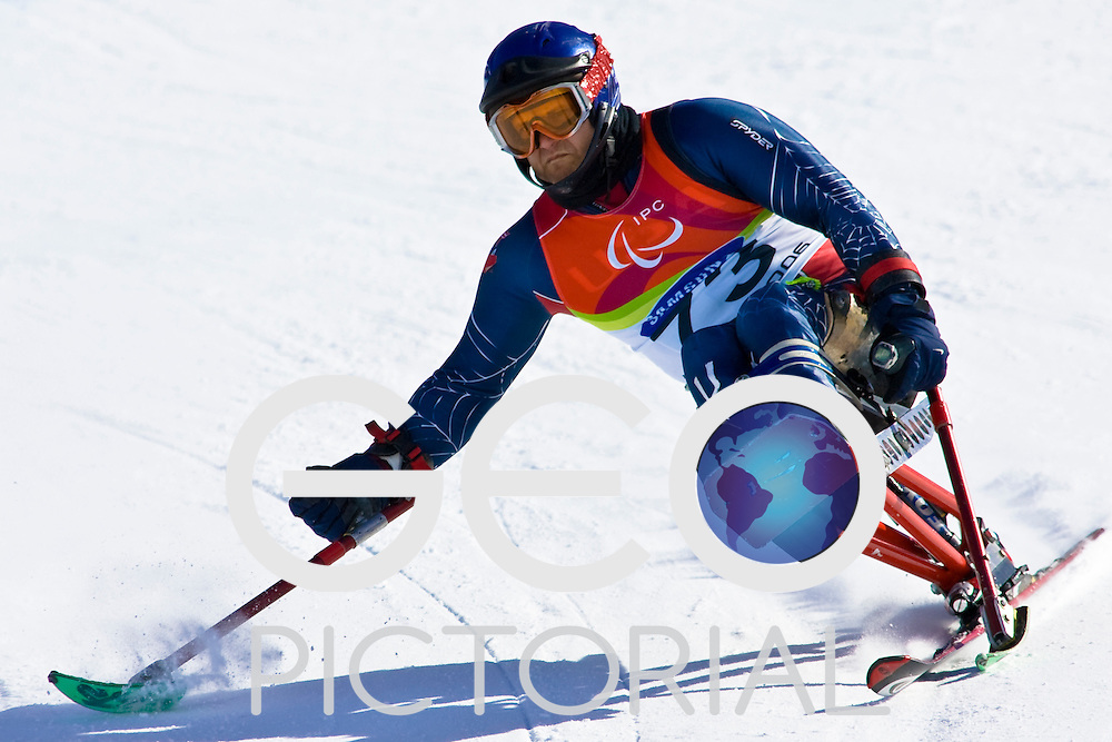 SESTRIERE COLLE, ITALY - MARCH 17th : Erik Bayindirli of the USA in the Mens Alpine Skiing Giant Slalom Sitting competition on Day 7 of the 2006 Turin Winter Paralympic Games on March 17th, 2006 in Sestriere Borgata, Italy.