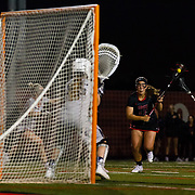 23 March 2018:  San Diego State Aztecs midfielder Harlowe Steele takes the ball in from the free position and scores in the second half. The Aztecs beat the Lady Flames 11-10 Friday night. <br /> More game action at sdsuaztecphotos.com