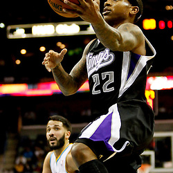 Jan 21, 2013; New Orleans, LA, USA; Sacramento Kings point guard Isaiah Thomas (22) shoots over New Orleans Hornets point guard Greivis Vasquez (21) during the third quarter of a game at the New Orleans Arena. The Hornets defeated the Kings 114-105. Mandatory Credit: Derick E. Hingle-USA TODAY Sports