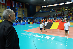 Belgium head coach Gert Vande Broek listens to his national anthem