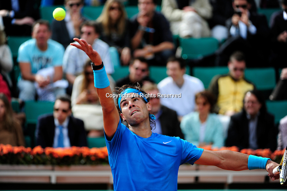 26.05.2011 French Open Tennis from Roland Garros Paris. Rafael Nadal of Spain prepares to serve in his match against Pablo Andujar of Spain on day five of the French Open tennis championships.