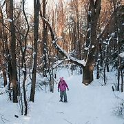 Ten year old Molly Mozell snowshoeing at Ipswich River Wildlife Sanctuary