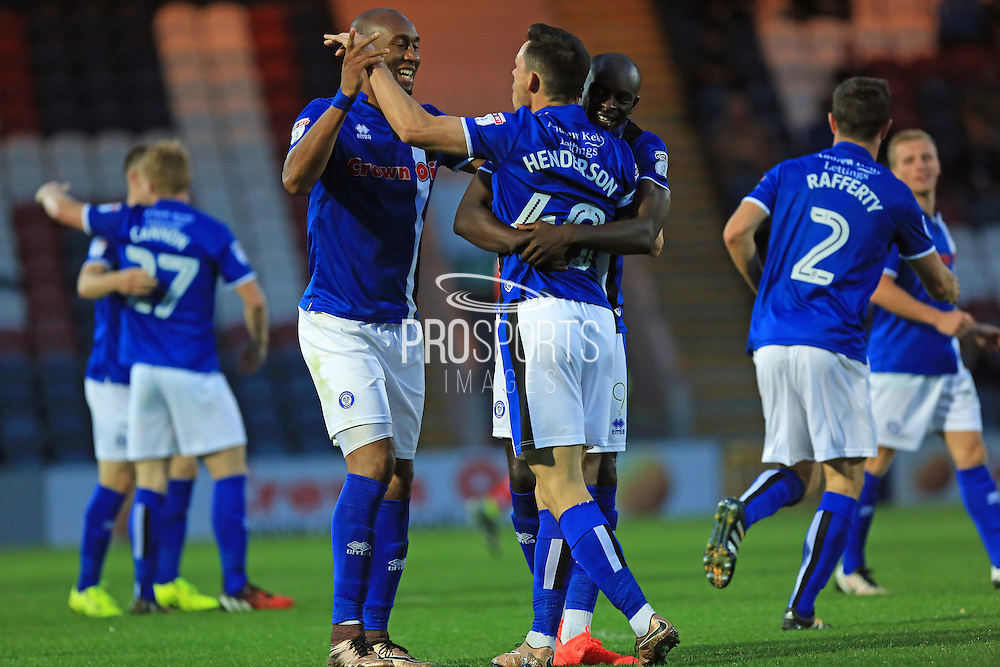 Ian Henderson with Calvin Andrew and Semni Odelusi celebrate 1-1 during the EFL Cup match between Rochdale and Chesterfield at Spotland, Rochdale, England on 9 August 2016. Photo by Daniel Youngs.