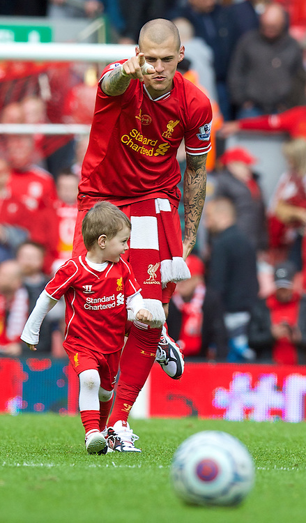LIVERPOOL, ENGLAND - Sunday, May 11, 2014: Liverpool's Martin Skrtel and his son Matteo up in the air after the final game of the Premiership season at Anfield. (Pic by David Rawcliffe/Propaganda)