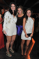 Left to right, ABBEY ROWTON, FELICITY McLEAN and ELLIE SHARPE at the launch party for the new nightclub Tonteria, 7-12 Sloane Square, London on 25th October 2012.