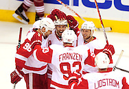 Apr 23, 2010; Glendale, AZ, USA; Detroit Red Wings center Pavel Datsyuk (13) celebrates with teammates after scoring a goal during the third period of game five in the first round of the 2010 Stanley Cup Playoffs at Jobing.com Arena.  Mandatory Credit: Jennifer Stewart-US PRESSWIRE
