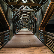 The covered bridge, a wooden structure spanning the Speed River, downtown Guelph. Photo by Andrew Goodwin