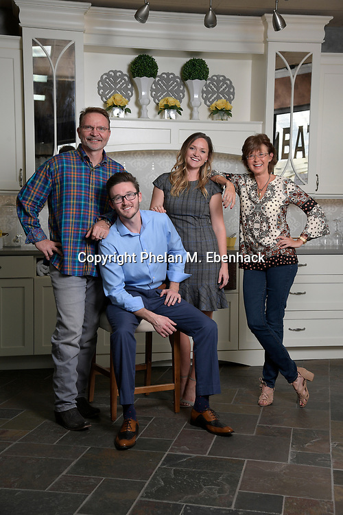 Keith Vellequette, left, owner and lead designer of KBF Design Gallery, poses with family members Ashley, second from right, Melissa, right, and Adam in their showroom Monday, Sept. 18, 2017, in Altamonte Springs, Fla. (Photo by Phelan M. Ebenhack)