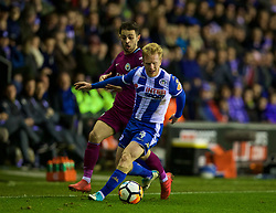 WIGAN, ENGLAND - Monday, February 19, 2018: Wigan Athletic's David Perkins and Manchester City's Bernardo Silva during the FA Cup 5th Round match between Wigan Athletic FC and Manchester City FC at the DW Stadium. (Pic by David Rawcliffe/Propaganda)