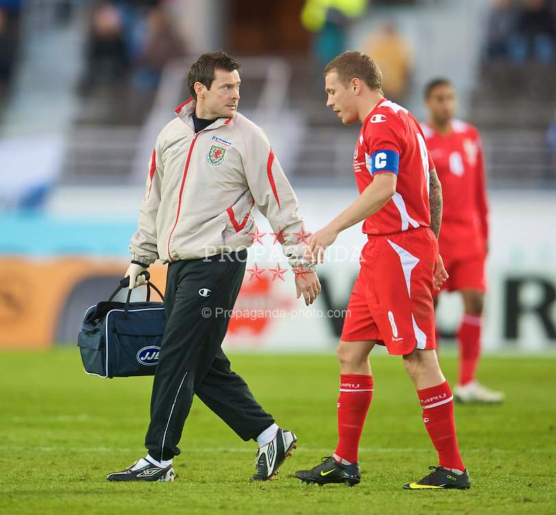 HELSINKI, FINLAND - Saturday, October 10, 2009: Wales' captain Craig Bellamy and physiotherapist Dyfri Owen during the 2010 FIFA World Cup Qualifying Group 4 match against Finland at the Olympic Stadium. (Pic by David Rawcliffe/Propaganda)