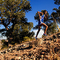 110114  Adron Gardner/Independent<br /> <br /> Navajo Pine Warrior Annoesika Laughlin pushes to the summit of Heartbreak Hill during the district cross country meet in Navajo Saturday.  Laughlin finished first with time of 20:57.