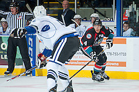 KELOWNA, CANADA - SEPTEMBER 28:  Madison Bowey #4 of the Kelowna Rockets looks for the pass against the Victoria Royals  at the Kelowna Rockets on September 28, 2013 at Prospera Place in Kelowna, British Columbia, Canada (Photo by Marissa Baecker/Shoot the Breeze) *** Local Caption ***