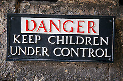 Warning sign; asking for children to be kept under control,