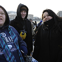 Chelsea Hood (L) of East Haddam, CT., Paden Livingston (C) of Chelton CT., and Lorrela Pareli (R) of New Milford, CT arrive at the reflecting pool at the Capital for the swearing in of Barack Obama as the 44th President of the United States of America during his Inauguration Ceremony on Capitol Hill in Washington on January 20, 2009.   (Mark Goldman/ Goldmine Photos)