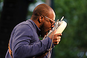 """Photos of musician Wyclef Jean performing at City Parks Foundation's SummerStage gala event, """"The Music of Jimi Hendrix"""", at Rumsey Playfield in Central Park, NYC. June 5, 2012. Copyright © 2012 Matthew Eisman. All Rights Reserved."""