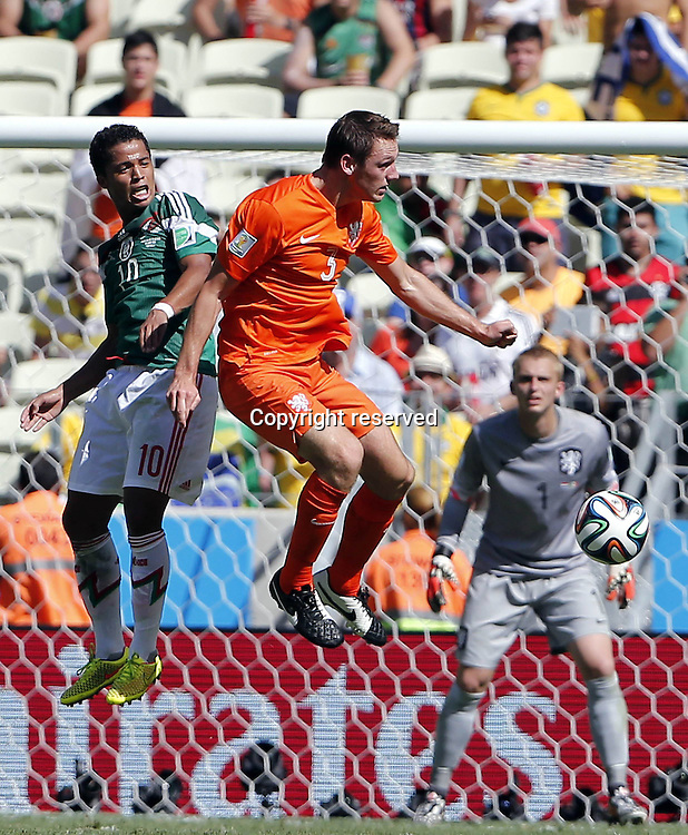29.06.2014. Fortaleza, Brazil. Mexicos Giovani dos Santoos challenges Netherlands Stefan de Vrij during a Round of 16 match between Netherlands and Mexico of 2014 FIFA World Cup at the Estadio Castelao Stadium in Fortaleza, Brazil, on June 29,