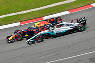Max Verstappen of Red Bull Racing and Lewis Hamilton of Mercedes AMG Petronas battle during the Malaysian Formula One Grand Prix at the Sepang International Circuit, Malaysia.<br /> Picture by EXPA Pictures/Focus Images Ltd 07814482222<br /> 01/10/2017<br /> *** UK &amp; IRELAND ONLY ***<br /> <br /> EXPA-EIB-171001-0252.jpg
