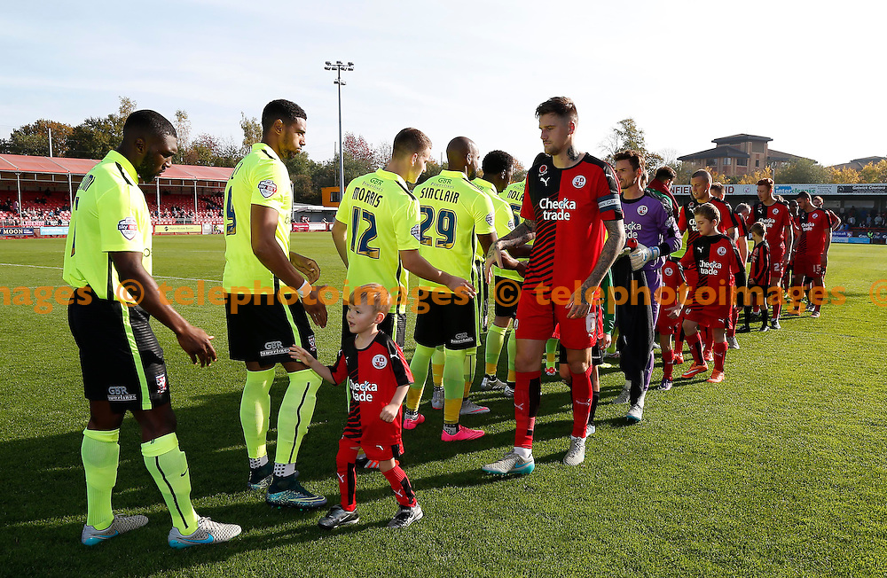 Team shake hands before the Sky Bet League 2 match between Crawley Town and York City at the Checkatrade.com Stadium in Crawley. October 31, 2015.<br /> James Boardman / Telephoto Images<br /> +44 7967 642437