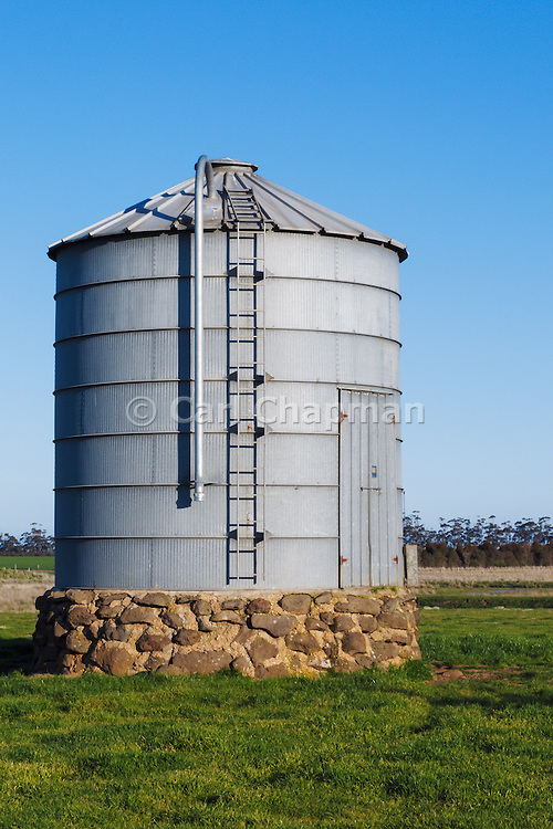 Grain silo in farm paddock in rural country Victoria, Australia.