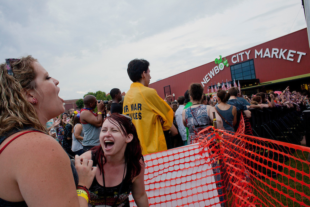 Casaundra Gaston and Rachael Stammer of Waterloo sing along to Allen Stone in the VIP area of the NewBo Music Fest in downtown Cedar Rapids on Saturday, August 8, 2015. Stammer won the passes in a KRNA contest and the two are avid fans of the day's headliners. (Rebecca F. Miller/Freelance for the Gazette)