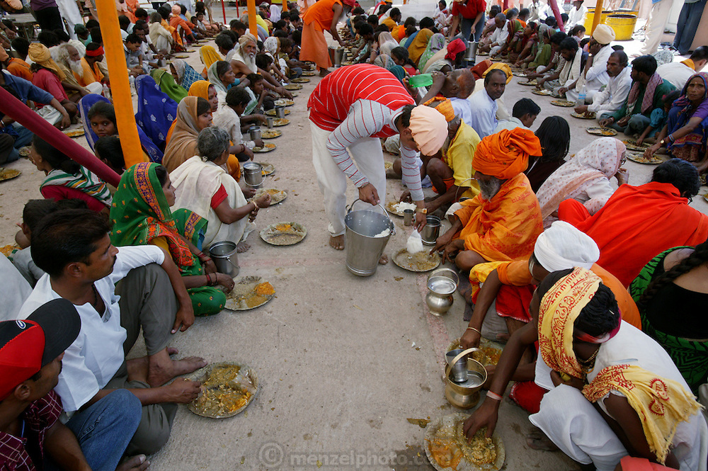 Worshippers eating at Sri Swami Santdas Udaasin Ashram, in Ujjain, India.